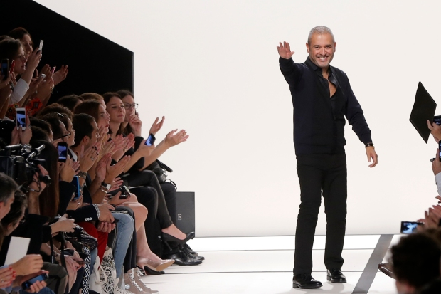 MoLebanese designer Elie Saab appears at the end of his Spring/Summer 2014 women's ready-to-wear collection during Paris Fashion Week